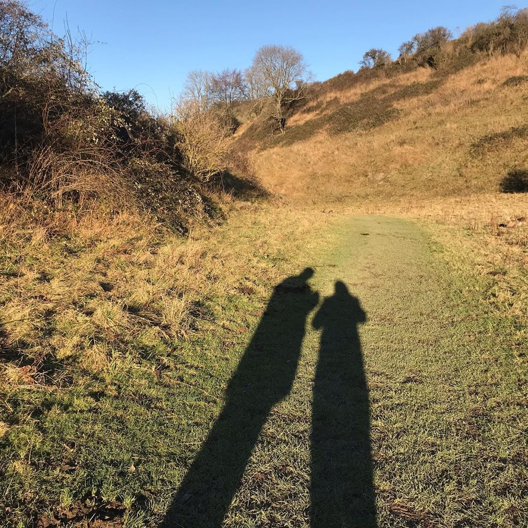 Laura and Will Duggan's shadows on the grass